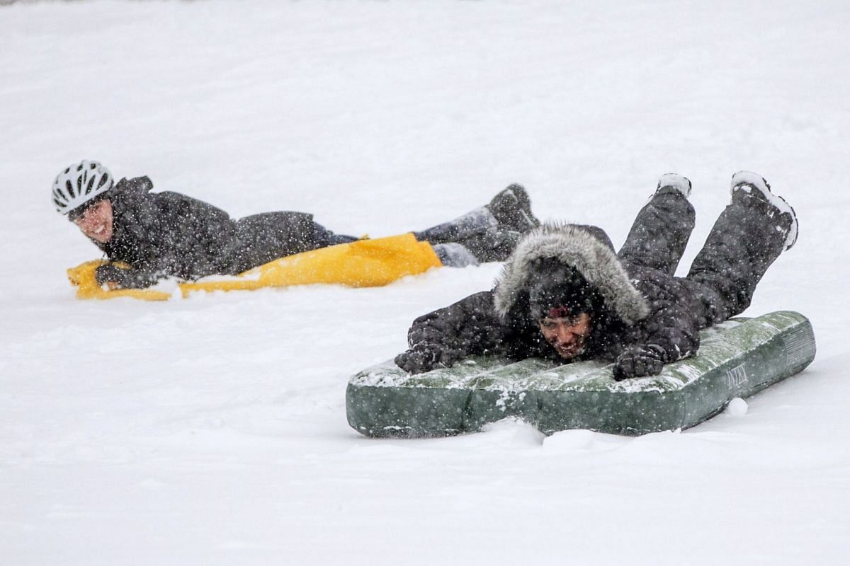 People sled on the Boston Common as Winter Storm Skylar bears down on March 13, 2018 in Boston, Massachusetts. This is the third nor'easter to hit the area in less than two weeks. PHOTO: GETTY IMAGES/AFP