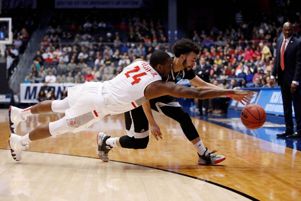 Ed Polite Jr. #24 of the Radford Highlanders and Julian Batts #1 of the Long Island Blackbirds battle for the ball during the second half of the First Four game in the 2018 NCAA Men's Basketball Tournament at UD Arena on March 13, 2018 in Dayton, Ohi