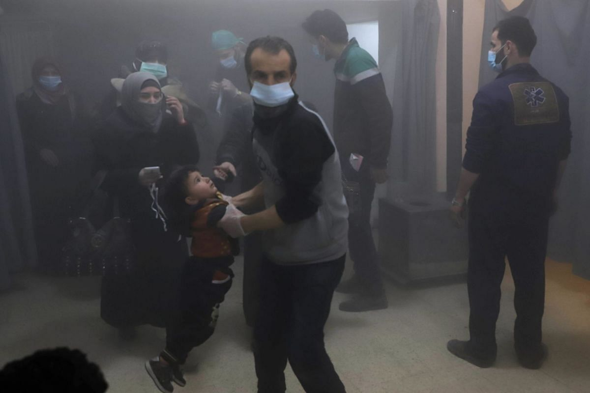 Syrian civilians arrive at a makeshift clinic during Syrian government air strikes on Zamalka, in the rebel enclave of Eastern Ghouta on the outskirts of Damascus on March 13, 2018. PHOTO: AFP