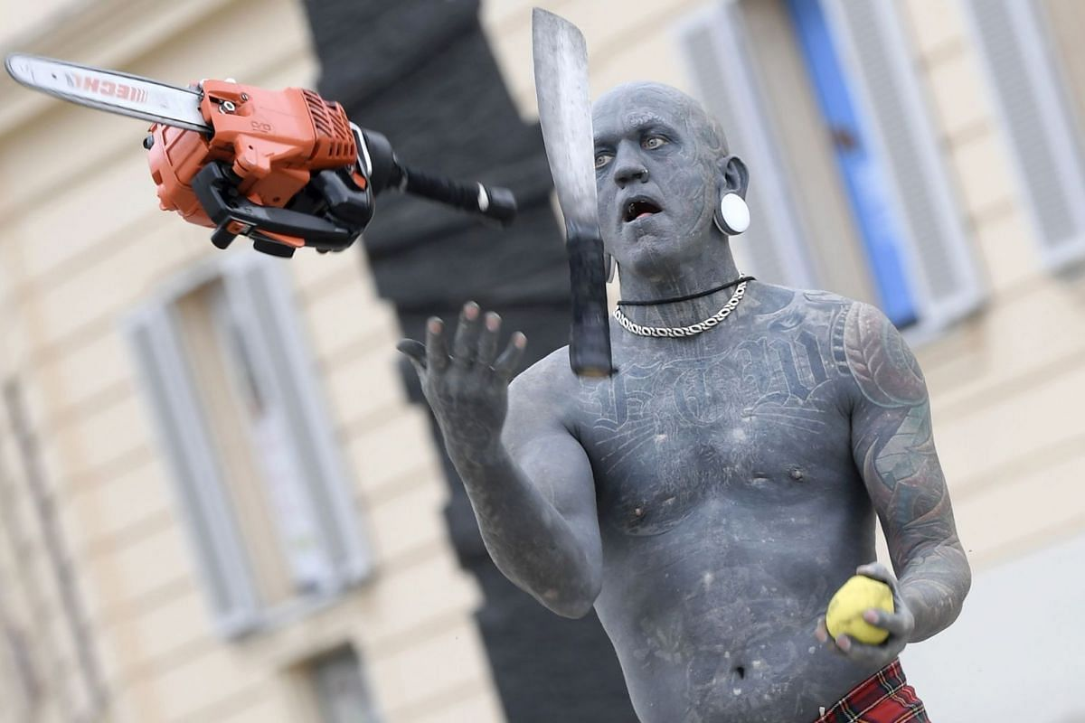 The world's most tattooed man, Gregory Paul Mclaren, performs as Lucky Diamond Rich during a photo session on March 14, 2018, in Vienna, Austria. PHOTO: AFP