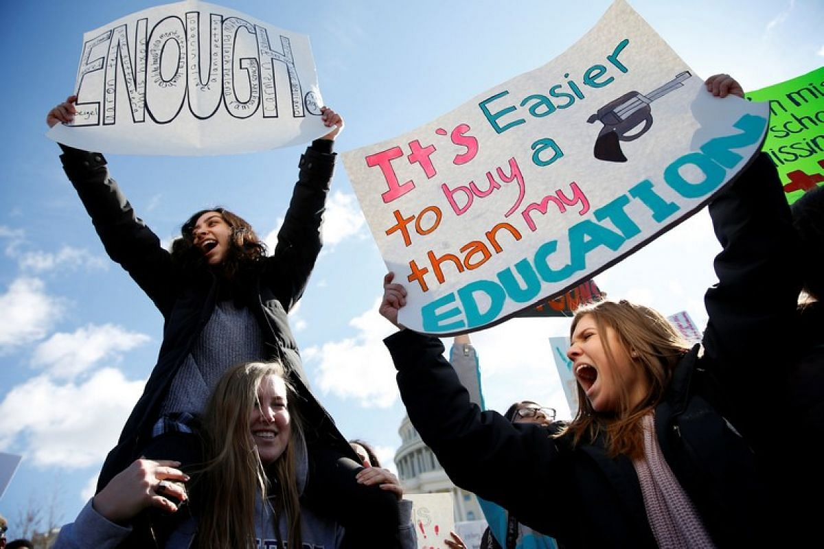 Students from Washington, DC-area schools protest for stricter gun control during a walkout by students at the US Capitol in Washington on March 14, 2018.