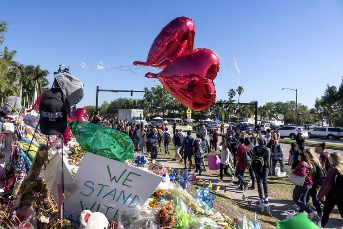 Community members and students participate of the national school walkout outside the Marjory Stoneman Douglas High School in Florida on March 14, 2018.