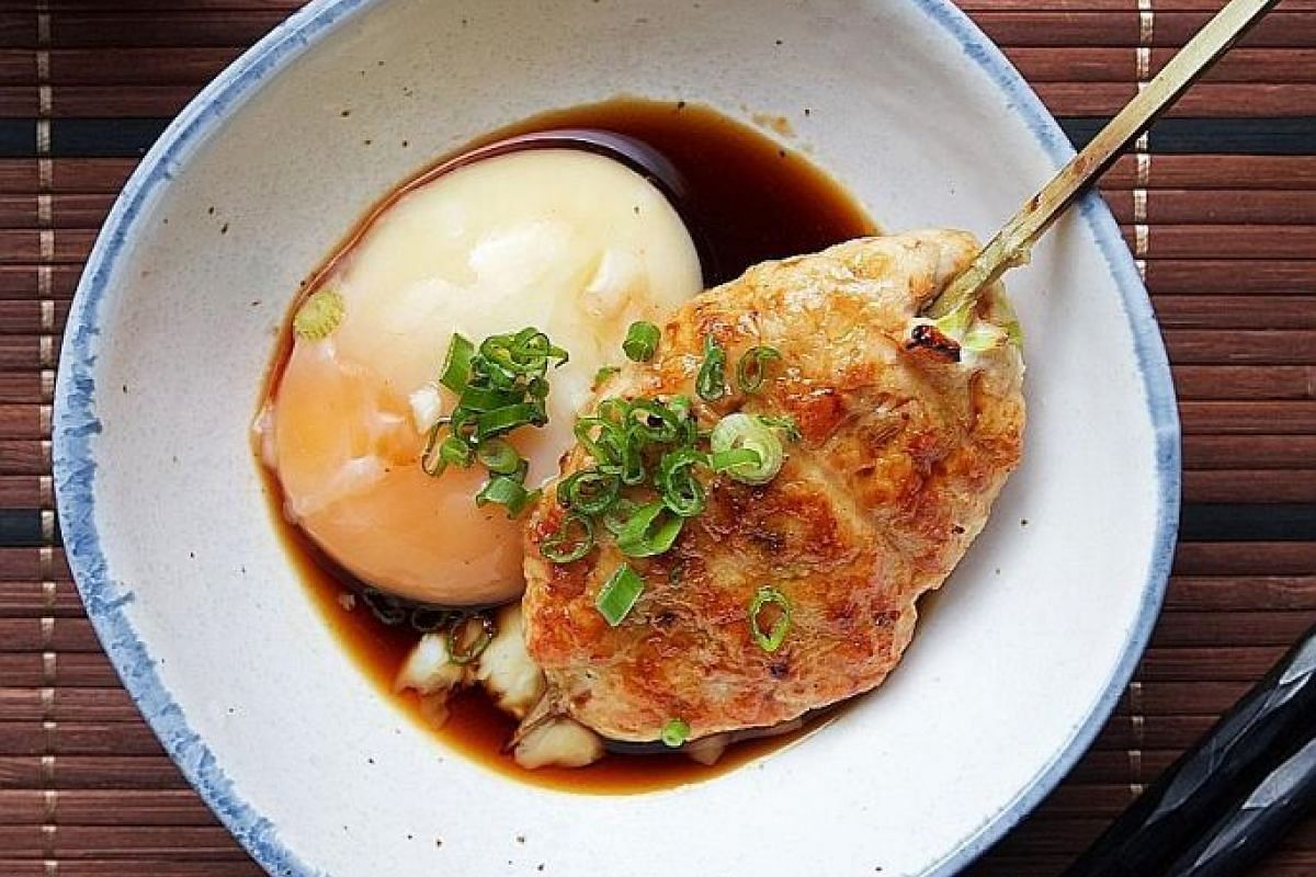 The Tsukune or chicken meatball comes as a big juicy patty and is served with a teriyaki dip with an onsen egg stirred in.