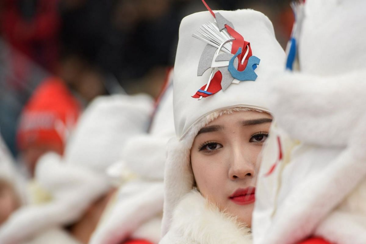 A tray-bearer at the flower ceremony for the Cross-Country Skiing event at the Alpensia Biathlon Centre during the 2018 Paralympic Winter Games in PyeongChang, South Korea, on March 18, 2018.