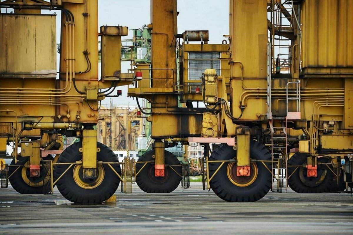 The RTGs, huge mobile cranes equipped with their own diesel generator systems, are used to stack containers in the yard.