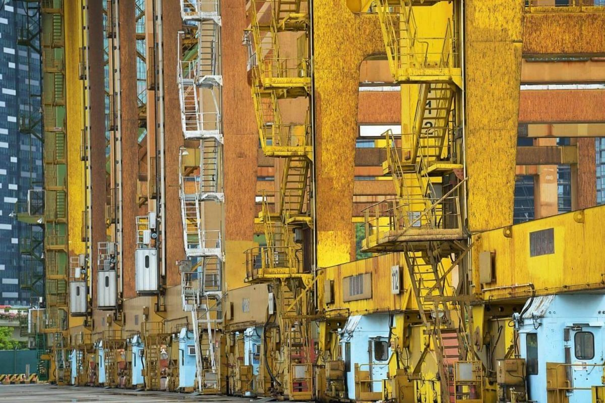 Quay cranes next to the wharves, ready to be dismantled and sold as scrap metal.