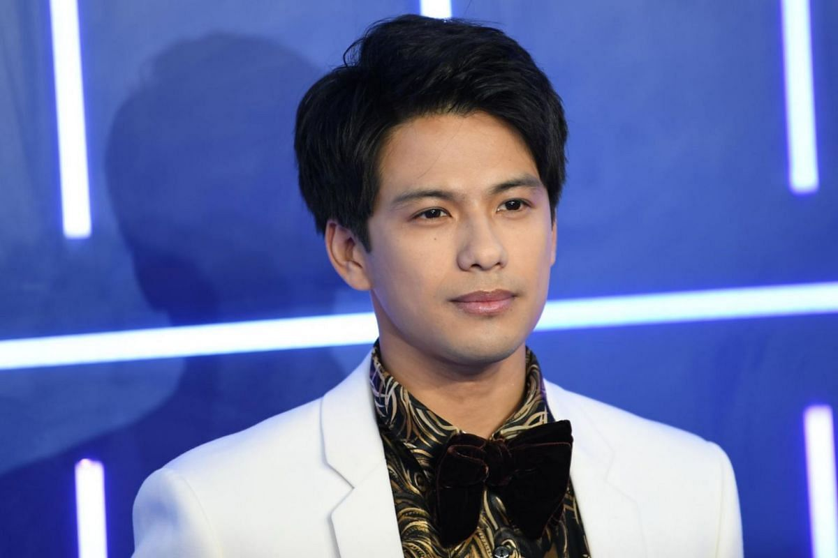 Japanese actor and cast member Win Morisaki posing for photos at the European premiere of the movie Ready Player One.