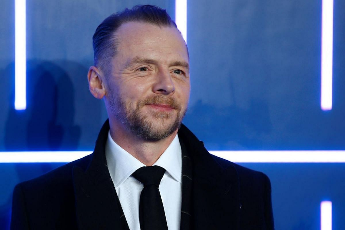 Actor Simon Pegg smiles for cameras at the European Premiere of Ready Player One.