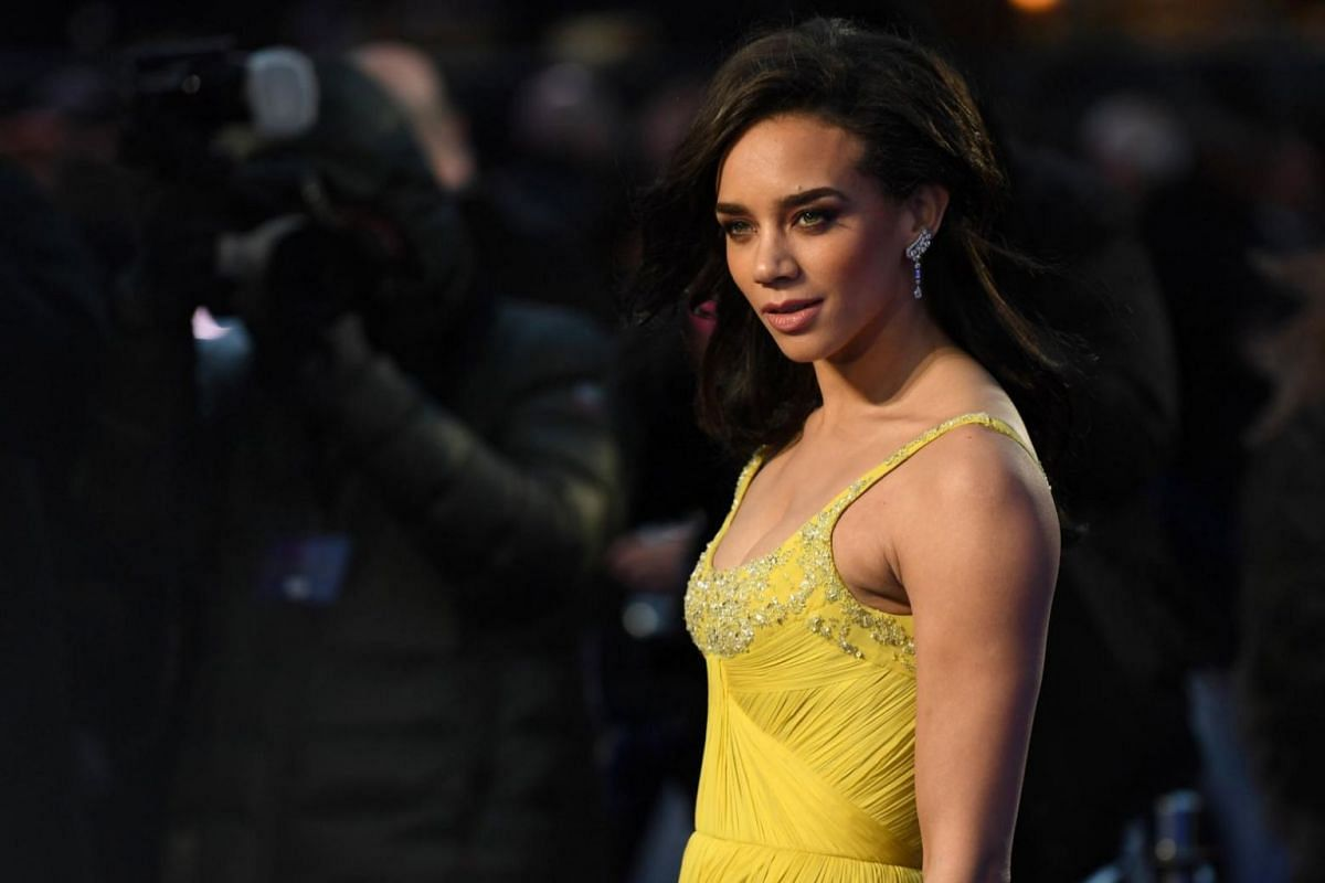 British actress and cast member Hannah John-Kamen posing for photos at the premiere of Ready Player One in London.