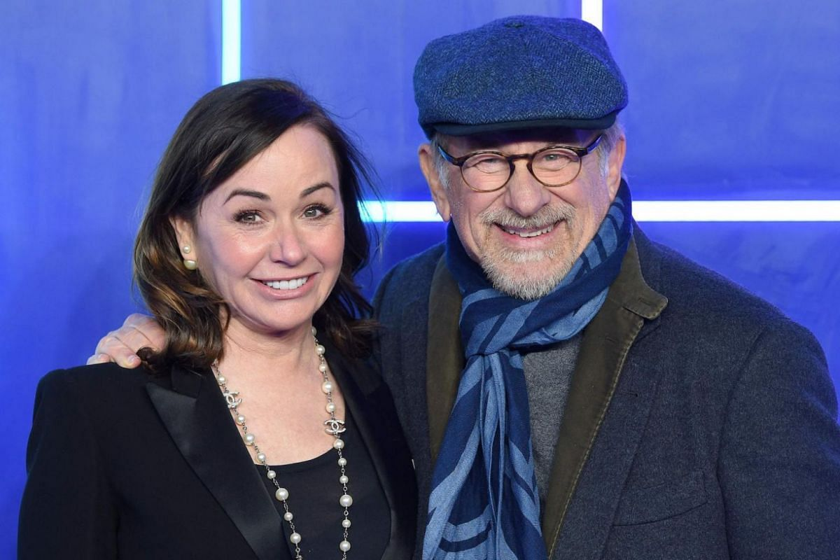 Director Steven Spielberg and producer Kristie Macosko Krieger pose on the red carpet upon arrival at the premiere of the film Ready Player One in London.