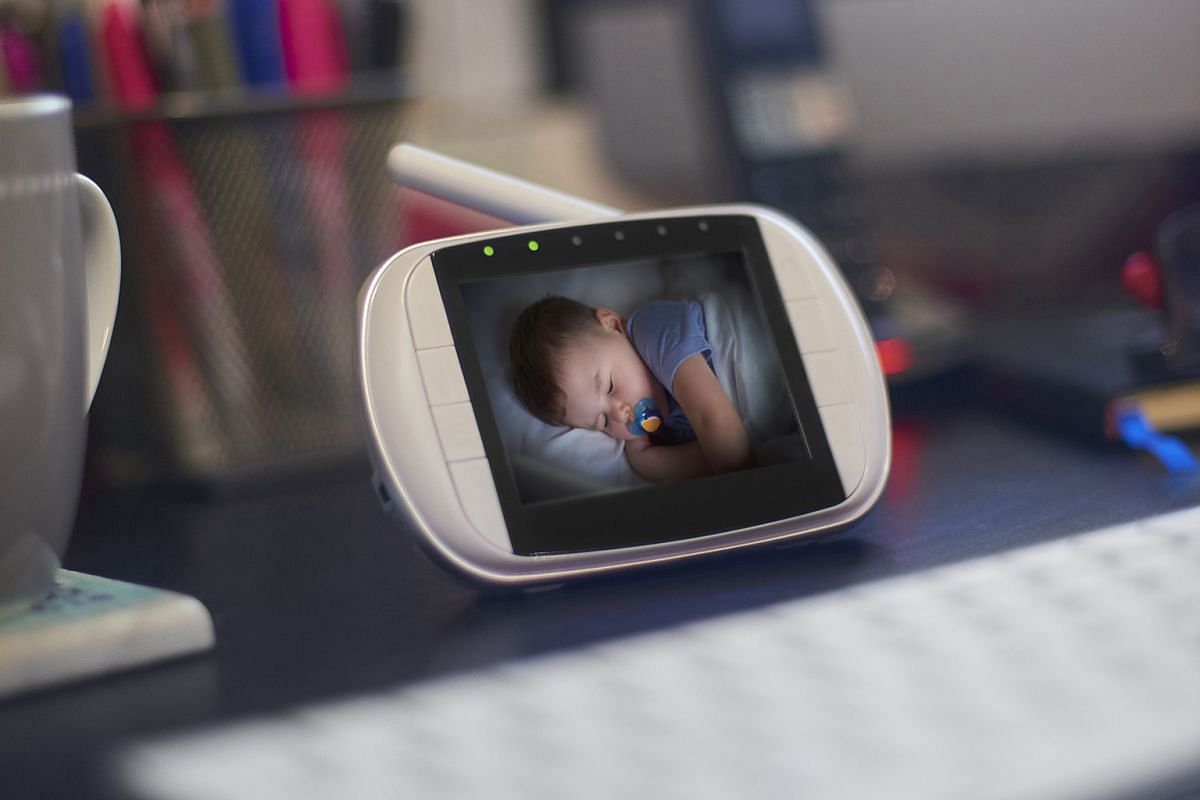 Parents can keep a remote eye on their children while at work using a baby monitor.