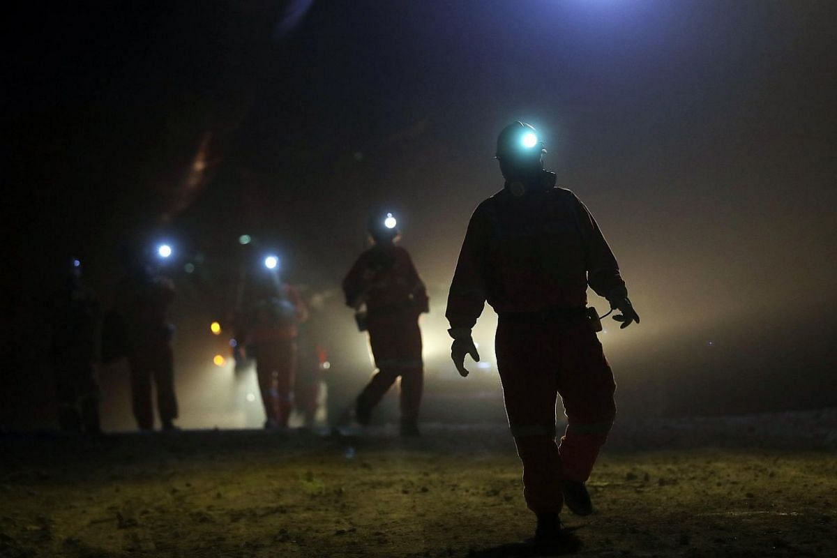 Miners walk through a section of the El Teniente mine in Rancagua, Chile, on March 21, 2018.