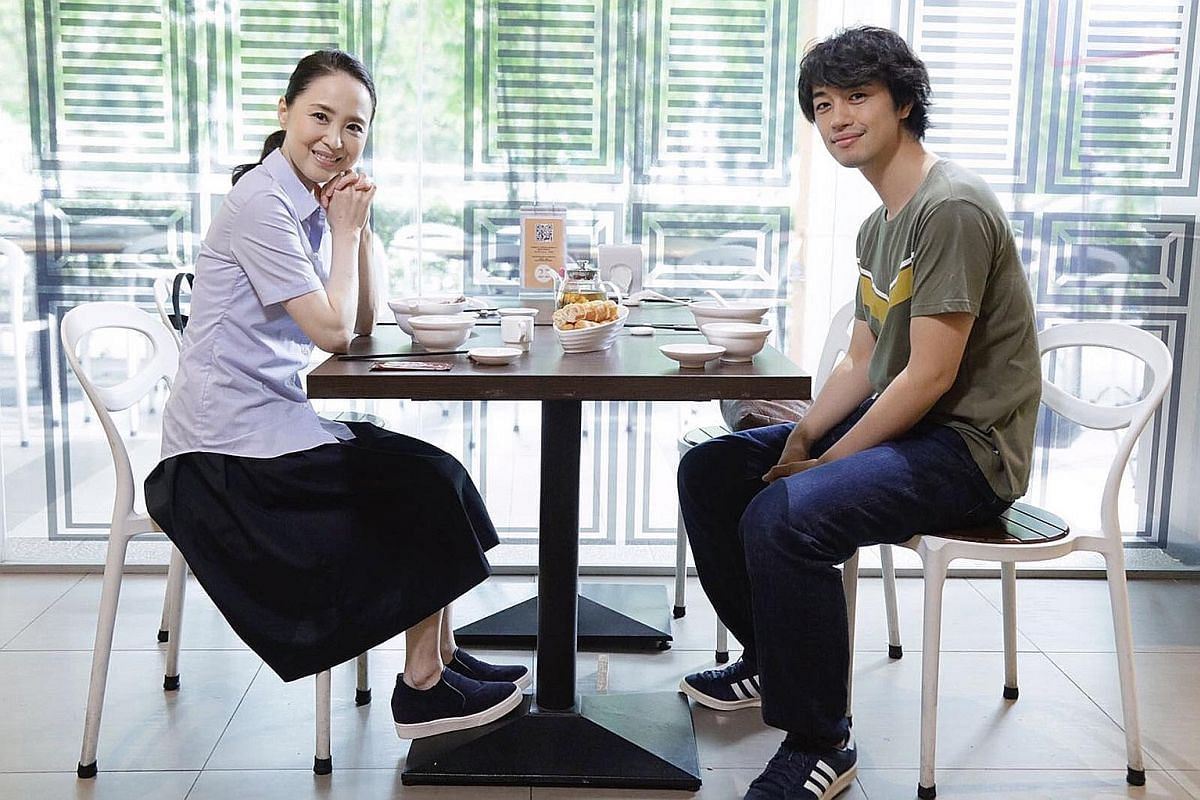 In the film Ramen Teh, Seiko Matsuda (left) plays a single mother and food blogger who develops a bond with a young ramen chef played by Takumi Saitoh (right).