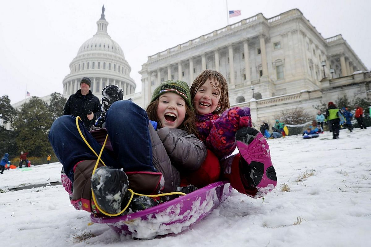 People snow sled on the grounds of the US Capitol on March 21, 2018 in Washington, DC.