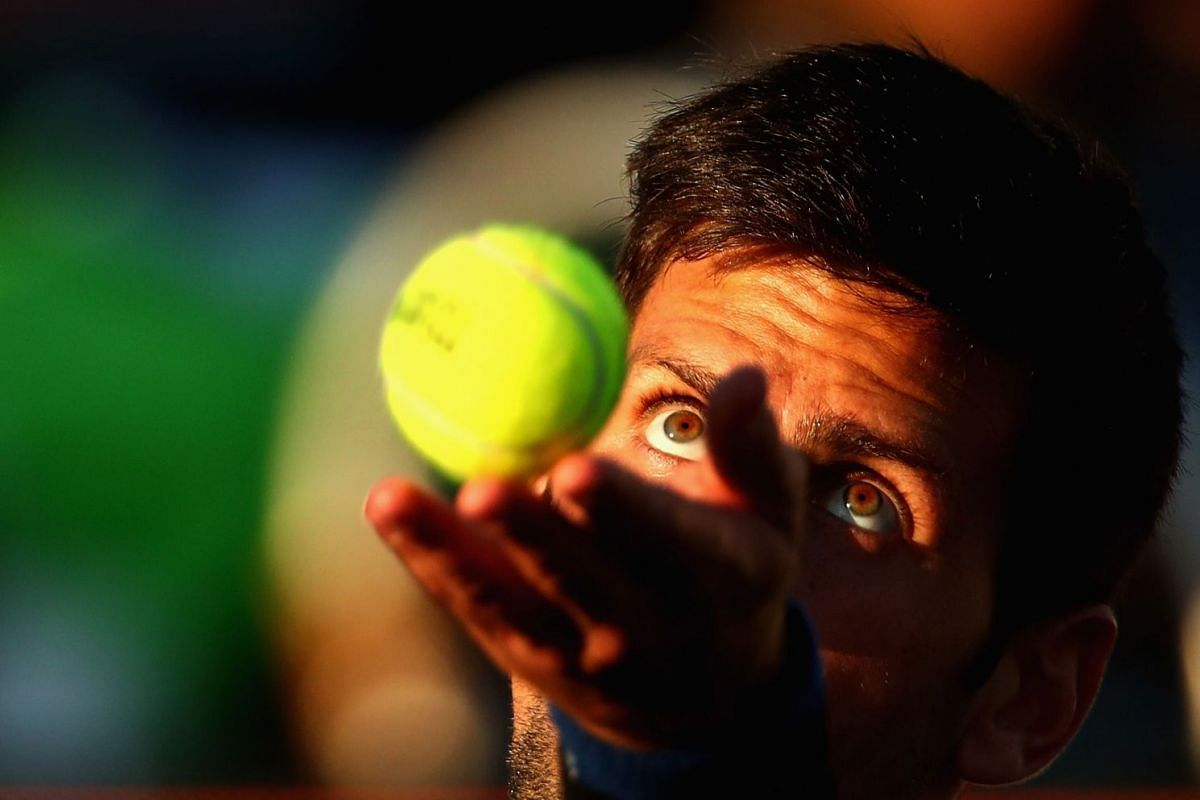 Novak Djokovic of Serbia serves during his first round doubles match during the Miami Open at Crandon Park Tennis Center on March 22, 2018.