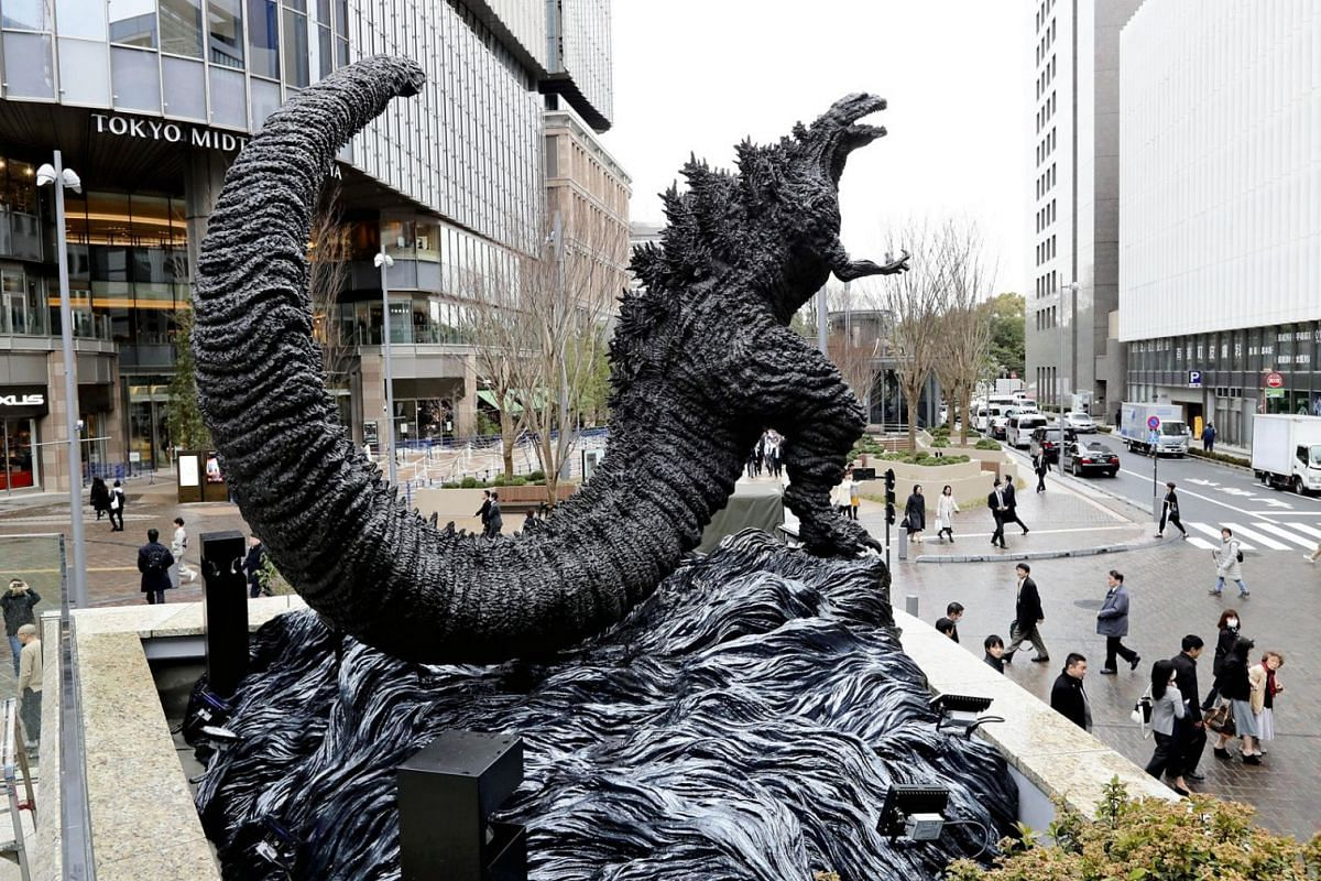 A new Godzilla statue makes its appearance at a square in front of the commercial complex Hibiya Chanter in Tokyo on March 22, 2018.
