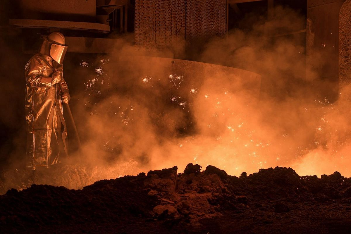 A steel worker at the blast furnace from the Salzgitter AG in Salzgitter, Germany, on March 22, 2018.