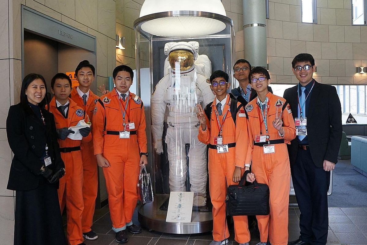 NUS High School students (in orange, from left) Fu Tianyi, 14, Kim Yongbeom, 15, Paul Seow Jian Hao, 14, Srivathsan Ram, 14, and Alexander Goo Zong Han, 14, after a mock astronaut training exercise. With them are Singapore Space and Technology Association