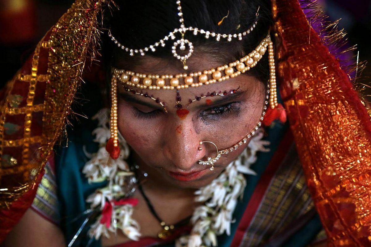 A blind Indian bride at a mass marriage ceremony for blind and handicapped people at Ulhasnagar in Thane, on the outskirts of Mumbai, on March 25, 2018.