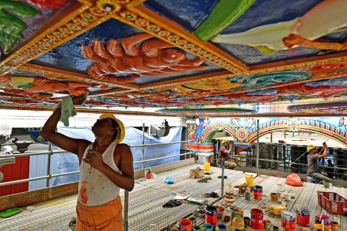 Mr Karuppaiyan Chidambaranathan wipes the excess paint off from a motif on the ceiling of the main hall at Sri Srinivasa Perumal Temple on Jan 5, 2018.