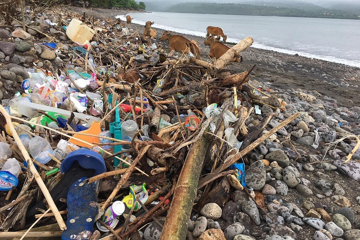 Plastic waste piles up on a beach to the north of Bima city on Indonesia's Sumbawa Island. The country is one of the world's top sources of marine plastic waste, leading to clogged-up rivers, coastlines and coral reefs.