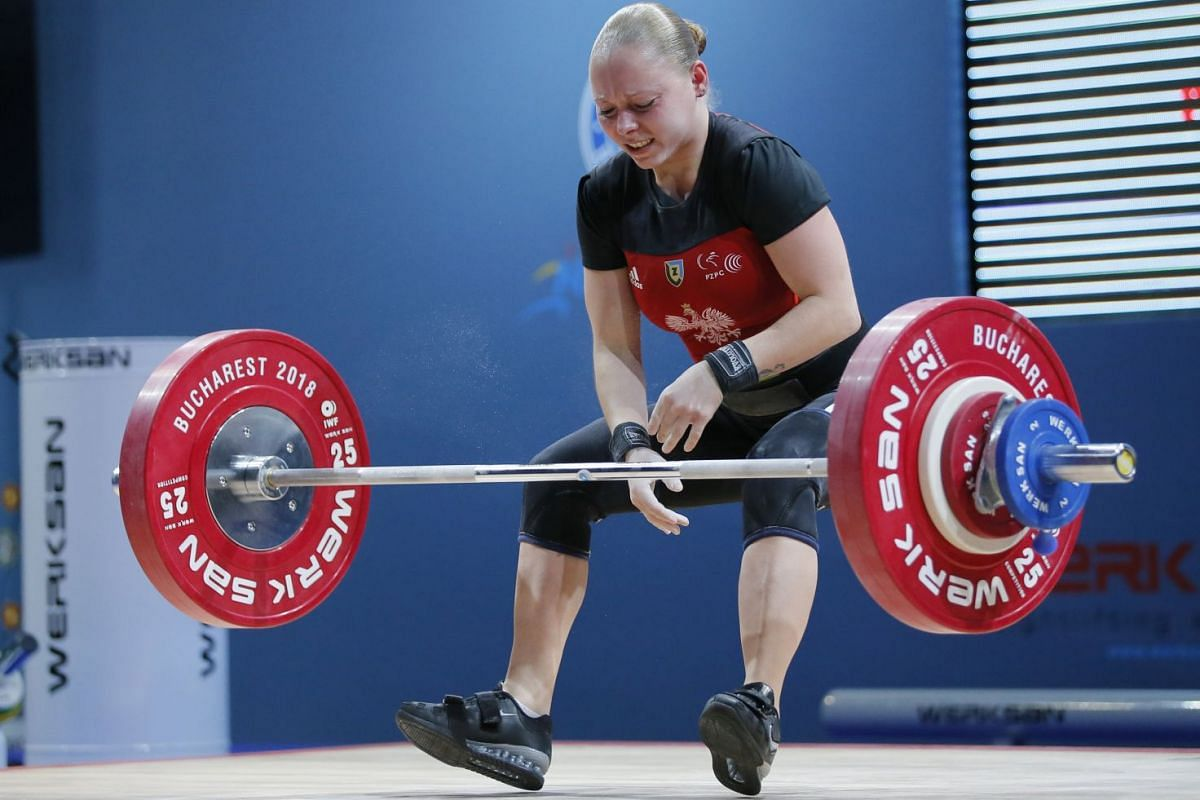 Agnieszka Zacharek of Poland makes an attempt during the women's 48kg final of the Weightlifting European Championships 2018, held at the Olympic Center in Izvorani village, Romania, on March 26, 2018.