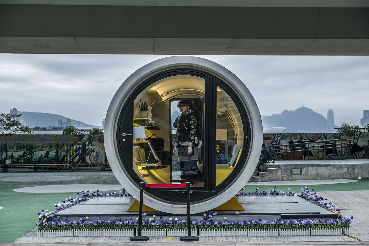 A person tours a prototype of the OPod, designed by the architect James Law, which would create a living space of about 100 square feet out of concrete drainpipes, in Hong Kong, on Feb 23, 2018.