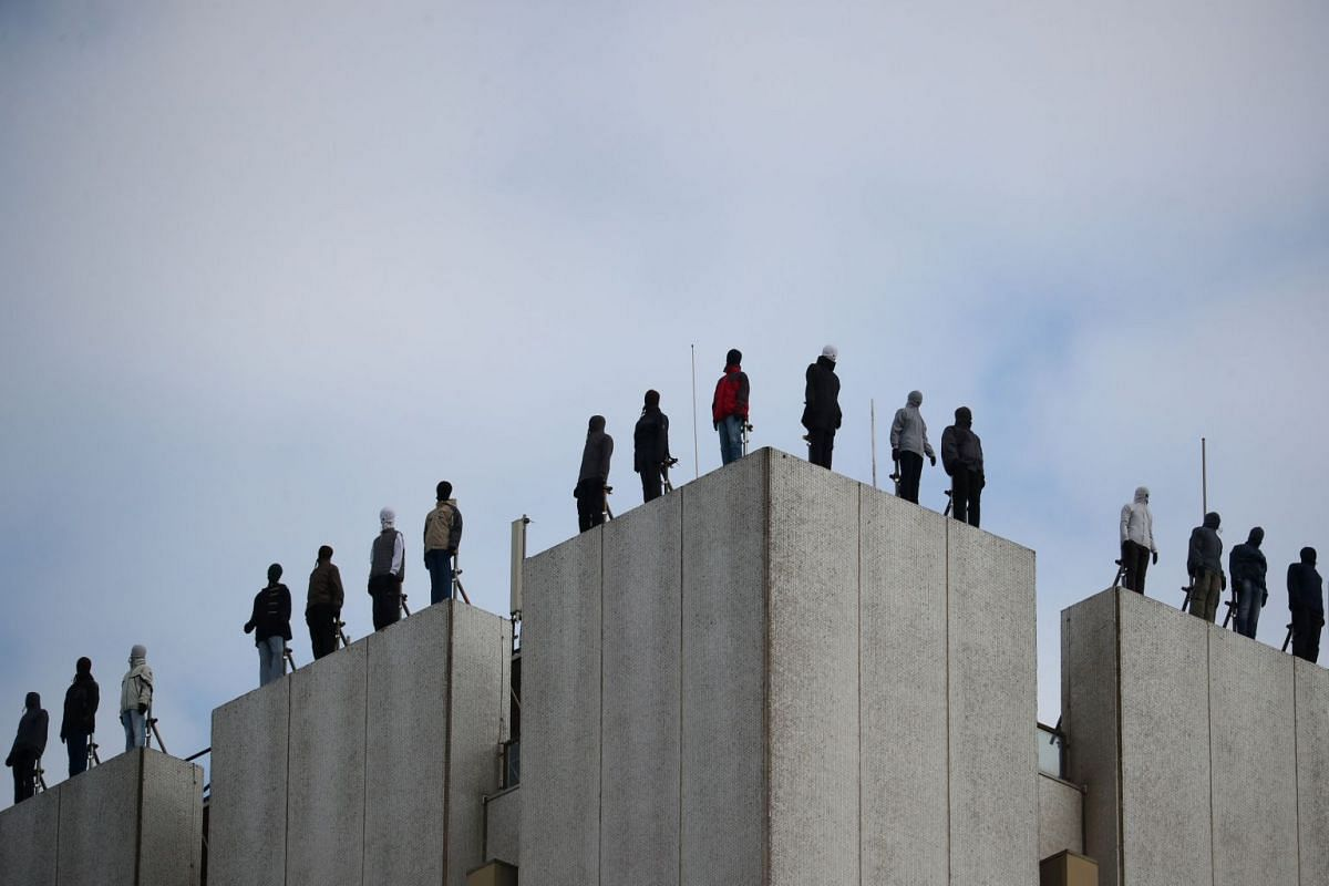 An art installation by US sculptor Mark Jenkins called Project 84, which aims to raise awareness of male suicide rates in the United Kingdom, is seen on the roof of a building in central London, Britain, on March 26, 2018.