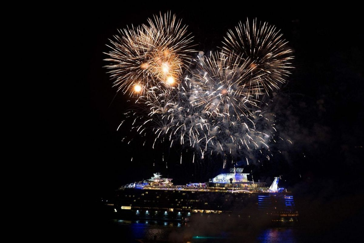 Fireworks light the sky over Royal Caribbean's Symphony of the Seas ship during its presentation in Malaga, Spain, on March 27, 2018.