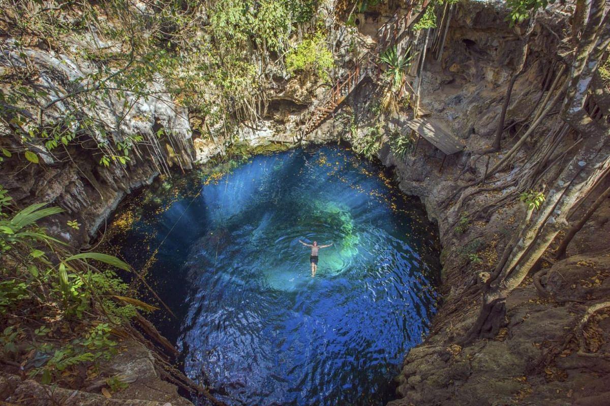 A man swimming in a cenote near Merida in Mexico.