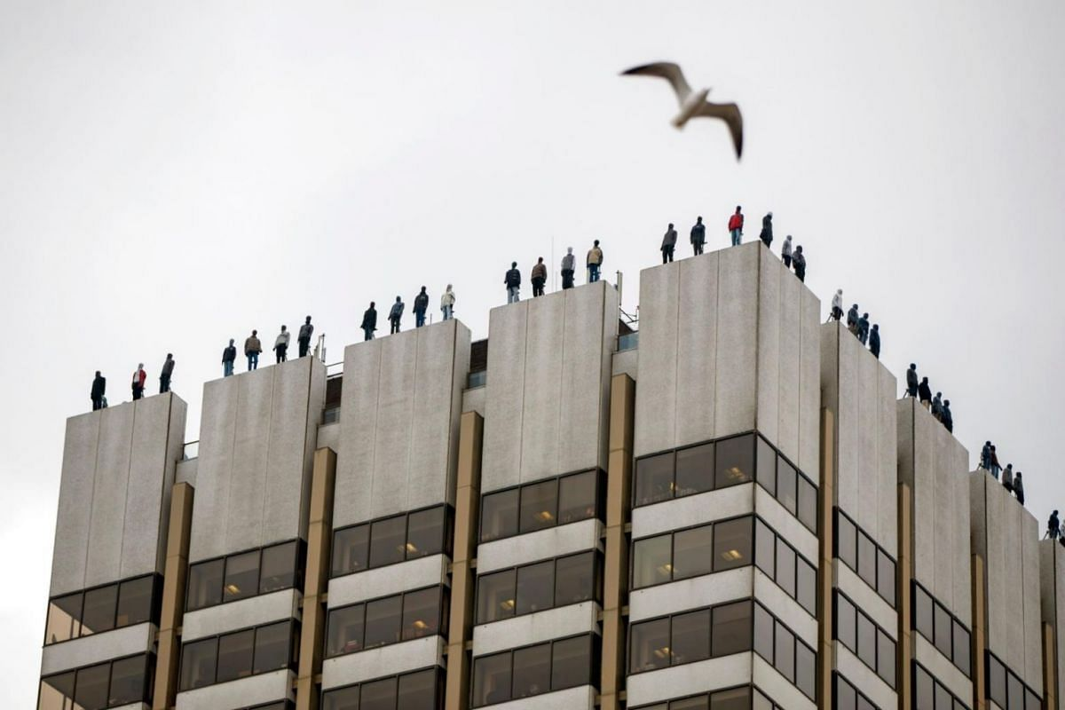 Life-sized sculptures of 84 men positioned on the roof of the ITV Television Centre building in London on March 27, 2018, as part of Project 84, an initiative by Campaign Against Living Miserably to start a conversation about male suicide.