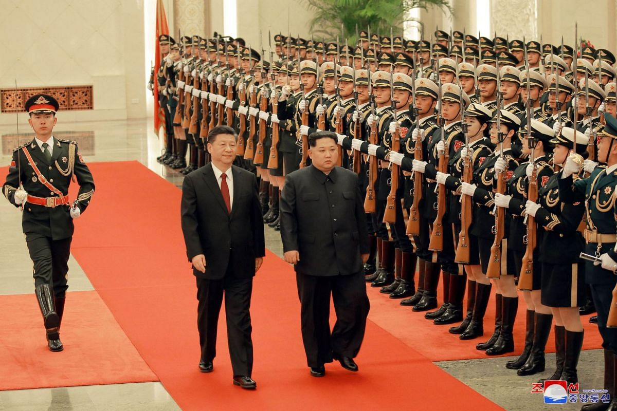 North Korean leader Kim Jong Un (right) and Chinese president Xi Jinping (left) inspect honour guards, as he paid an unofficial visit to China, on March 28, 2018.