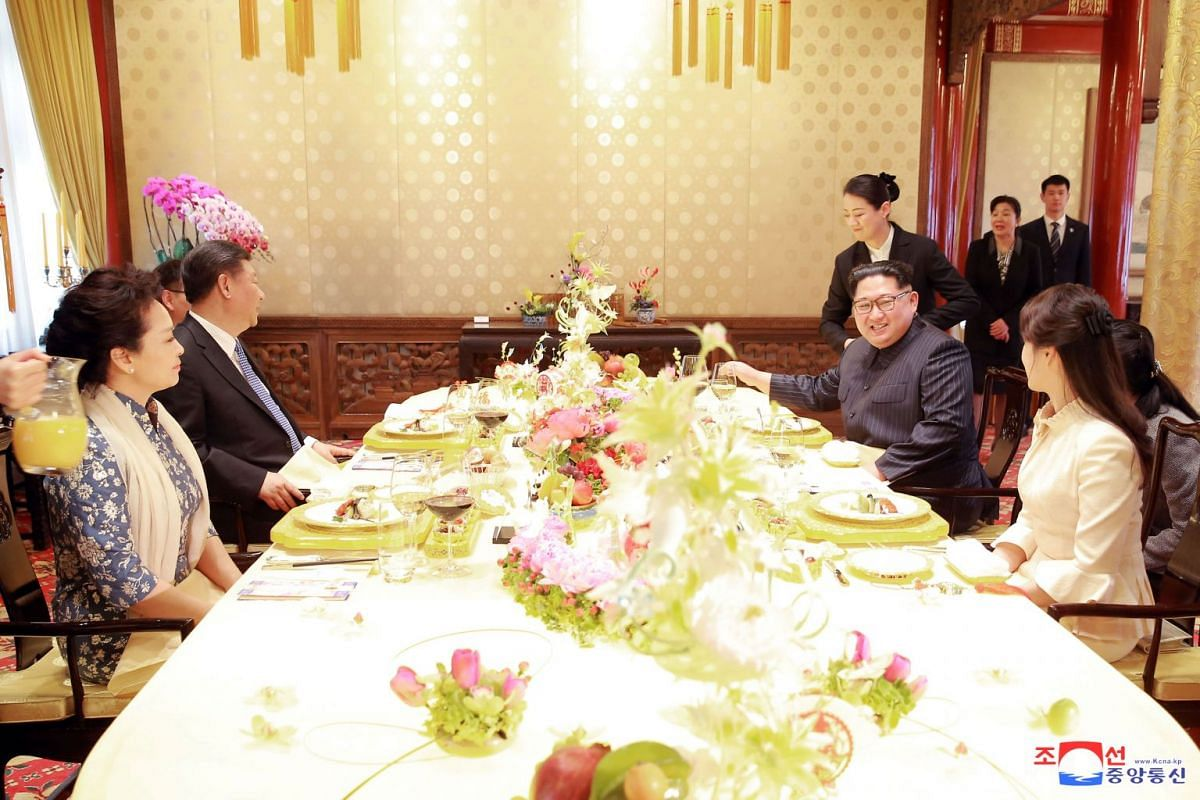 North Korean leader Kim Jong Un and wife Ri Sol Ju meets Chinese President Xi Jinping and wife Peng Liyuan.