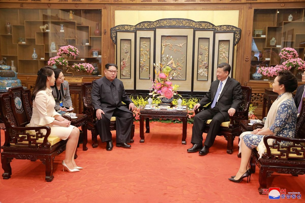 North Korean leader Kim Jong Un (third from left) and wife Ri Sol Ju (left) meet Chinese president Xi Jinping (second from right) and wife Peng Liyuan (right).