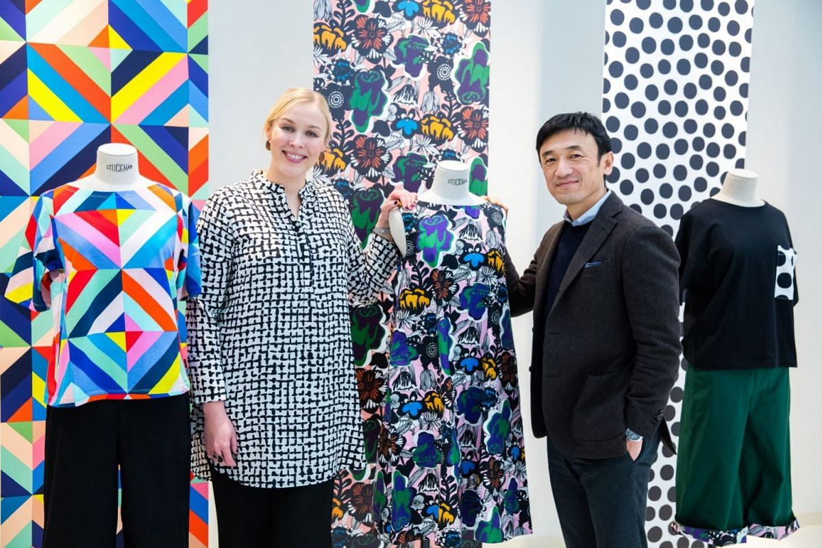 Ms Tiina Alahuhta-Kasko, president and chief executive of Marimekko Corporation, and Mr Yukihiro Katsuta, Uniqlo's head of research and design, with the Kukkia Rakkaalle floral print that has been designed for the collaboration.