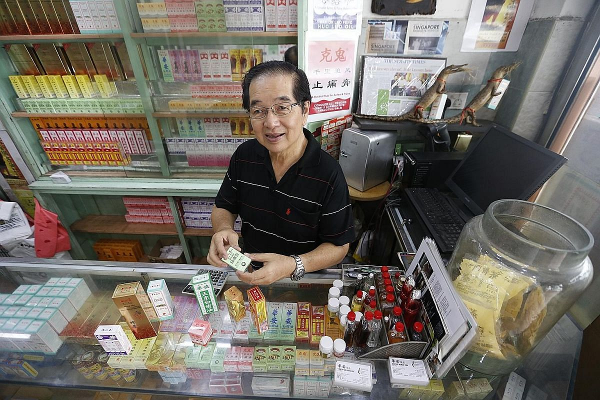 Third-generation owner of Chop Wah On, Mr Tong Kok Kong, with some of the best selling products sold in the store his grandfather set up.
