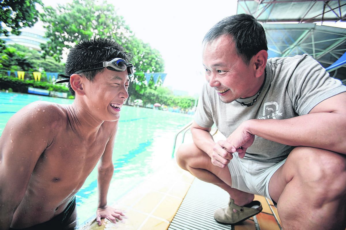 Ang Peng Siong having a laugh with his young trainee Benson at the Farrer Park Swimming Complex.