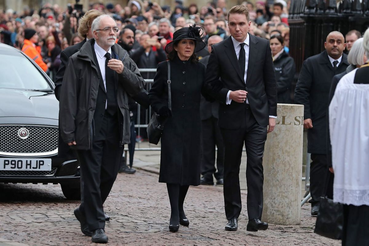 Jane Hawking (centre), first wife of Stephen Hawking, arrives with her son Tim (centre right) to attend his funeral.