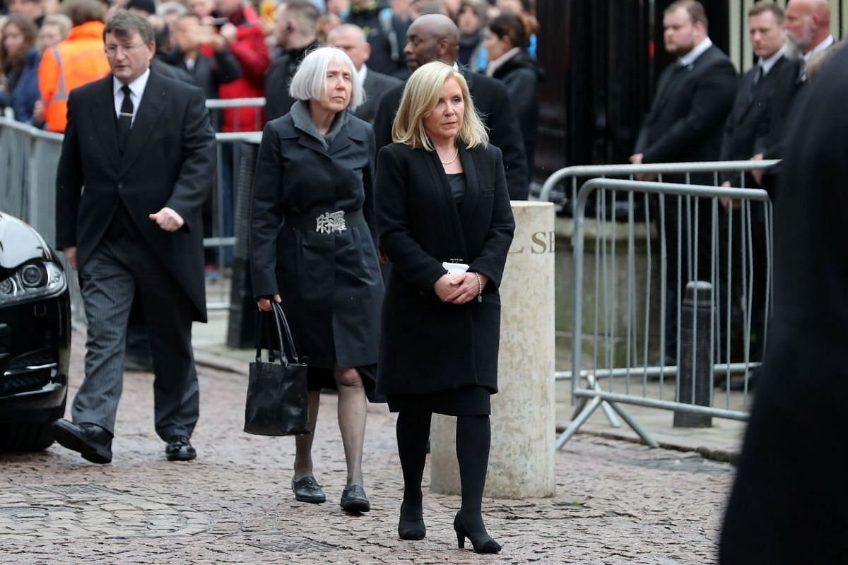 Lucy Hawking (centre), daugher of British scientist Stephen Hawking, arrives to attend his funeral at the Church of St Mary the Great in Cambridge on March 31, 2018.