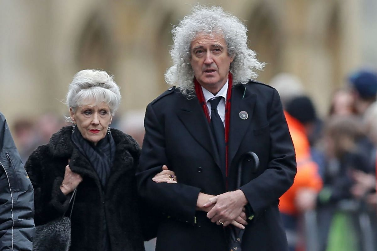 British musician Brian May and his wife, acress Anita Dobson, arrive to attend the funeral of British scientist Stephen Hawking at the Church of St Mary the Great in Cambridge on March 31, 2018.