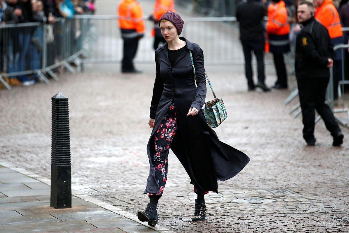 British model Lily Cole arrives at Great St Mary's Church in Cambridge, where the funeral of British scientist Stephen Hawking is being held on March 31, 2018.