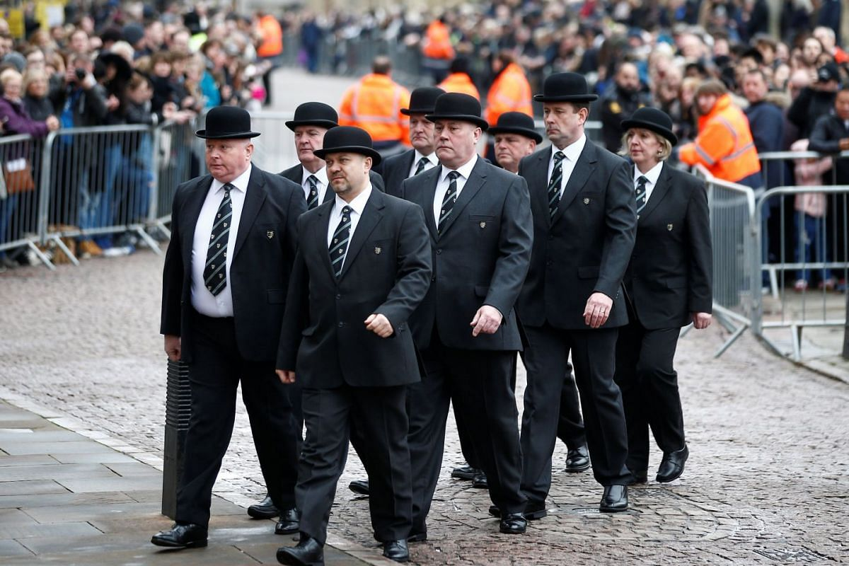 University of Cambridge college porters arrive at Great St Mary's Church, where the funeral of British scientist Stephen Hawking is being held on March 31, 2018.