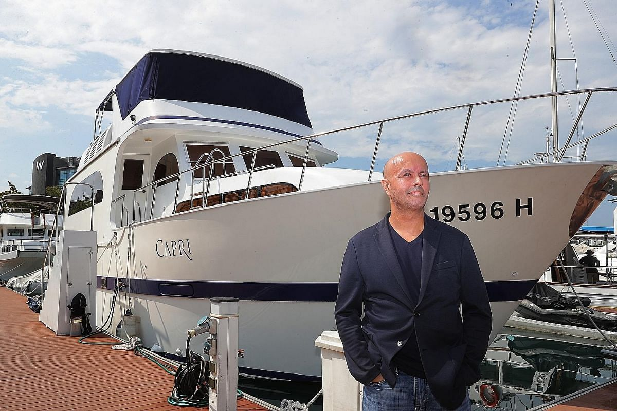 Mr Dany Bolduc called his 130 sq m yacht, Capri, home for seven years. The boat, berthed at a marina in Sentosa, had many of the amenities of a regular flat (far right). Staying on it was cheaper than renting an apartment of a similar size in a simil