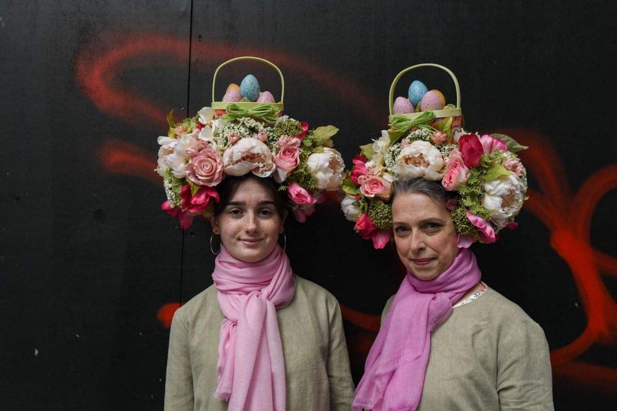 A mother and daughter wear Easter bonnets while participating in the annual Easter Parade along 5th Avenue in New York City on April 1, 2018.