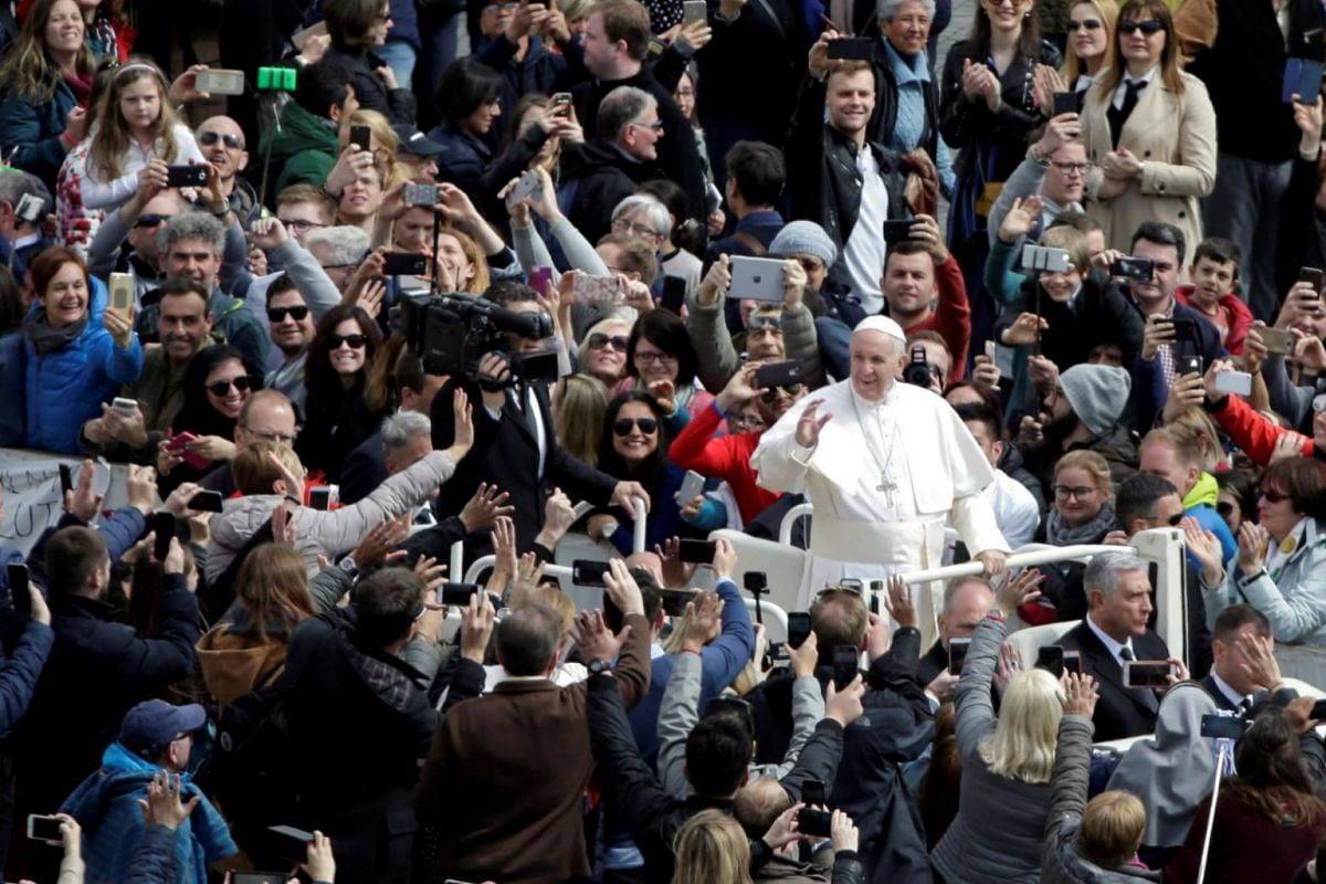 Pope Francis greeting visitors after the Easter Mass at St. Peter's Square in The Vatican.