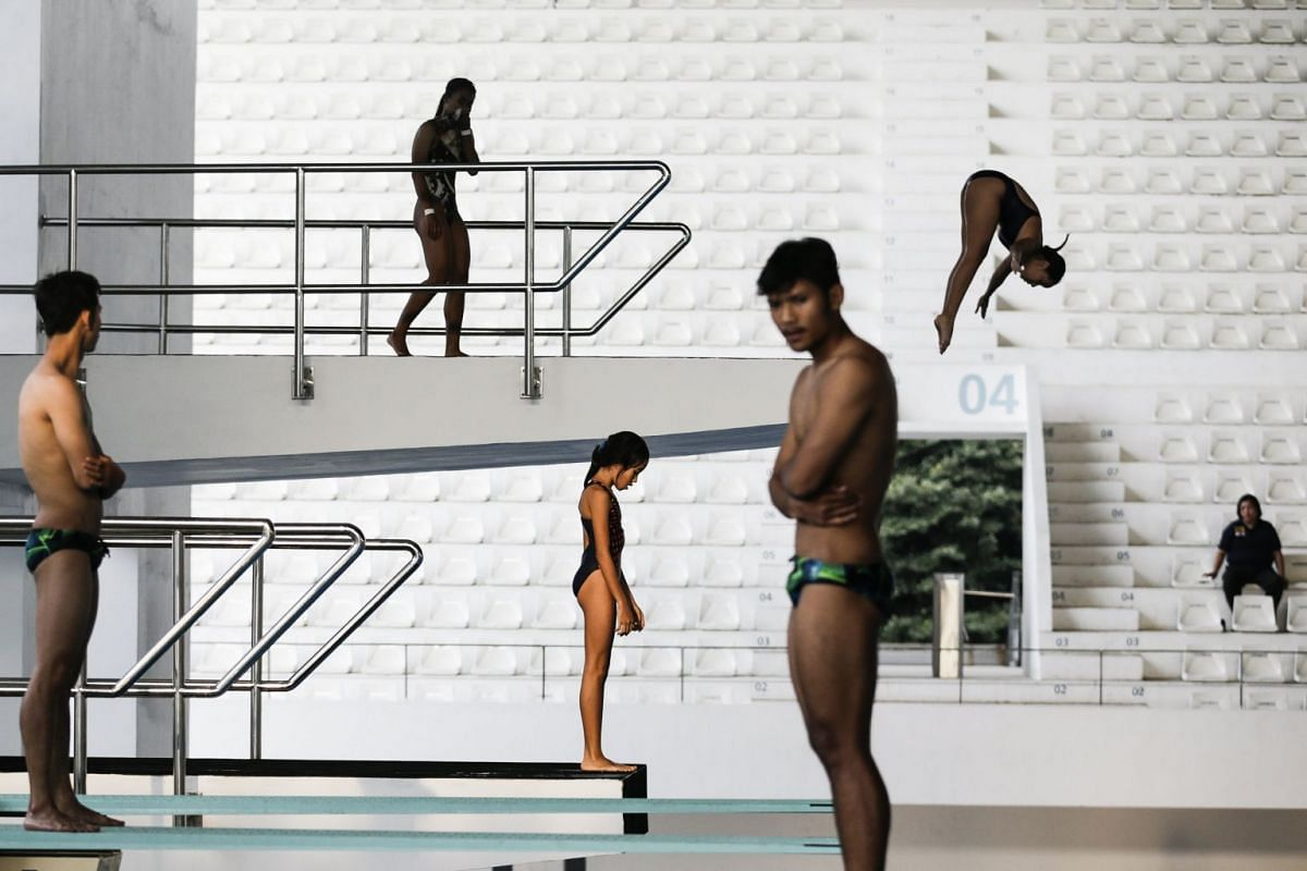 Indonesian divers practice inside the Aquatic Center at the main venue of upcoming Asian Games 2018 in the Gelora Bung Karno sports complex, Jakarta, Indonesia, on April 3, 2018.