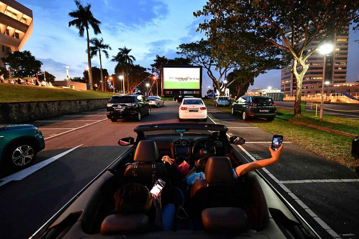Festival-goers watching They Call Her Cleopatra Wong at the Jurong drive-in cinema at the carpark of Jurong Town Hall, on April 6, 2018.
