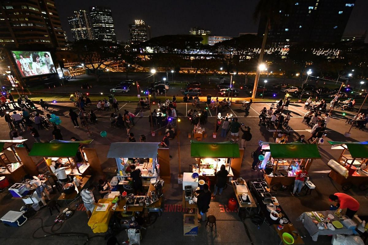 Festival-goers watching They Call Her Cleopatra Wong at the Jurong drive-in cinema and Singapore Hawkerpreneurs selling local favourites at the carpark of Jurong Town Hall, on April 6, 2018.