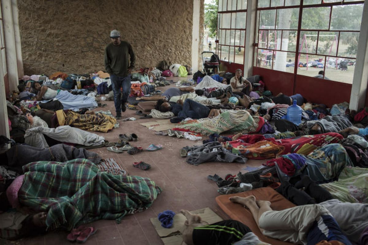 A group of Central American refugees and asylum seekers take shelter at the Community Sports Center in the town of Matias Romero, Oaxaca state, Mexico, on April 4, 2018.