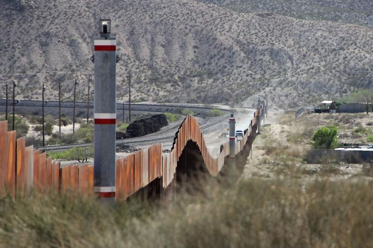 US border patrol keeping watch in El Paso in New Mexico State in the United States, as seen from across the US-Mexico border fence in the Anapra valley near Ciudad Juarez, Chihuahua State, Mexico, on April 5, 2018.
